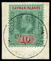 Lot 1475:1907-09 10/- green and red/green SG #34, fine used on piece with full strike of 1912 Georgetown double-ring datestamp, Cat £250.