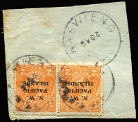 Lot 1409:Kavieng: twin strikes of Powell Type #40 'KAEWIENG' datestamp tying 2d orange SG #121 pair to small piece, another fine strike beneath, dateline inverted, year date absent, Rated D.