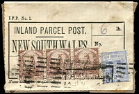 Lot 1008:C.1895 use of NSW Inland Parcel Post label (ref 'I.P.P. No.1'), for article weighing up to 6lbs, with 1/- purple-brown Roo strip of 3 and 2d QV all punctured with 'HB' perfin of Harrold Bros (shipping agents). Nice item.