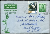 Lot 1490:1969 use of 6d QEII Aerogramme, uprated with 3c Bird for transit to USA. Rare, commercial usage.
