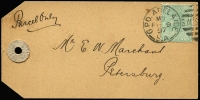 Lot 843:1897 (Feb 9) parcel label for S. Marshall & Sons, with QV 1d green tied by Adelaide datestamp, addressed to Petersburg (SA). Rare.
