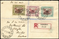 Lot 945 [1 of 2]:1930 'AIR MAIL' Plane Overprints 3d, 6d & 1/- the latter with overprint in dark carmine, SG #115-7 (variety) all VFU on registered cover from Samarai to England. The 1/- dark carmine overprint being extremely rare on cover with very few known. Ceremuga Certificate (2001).