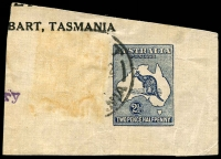Lot 588:1921 2½d Deep Blue Kangaroo cut-out on brown paper (added adhesive missing) cancelled at Hobart (in 1922?), and showing small portion of printing indicating use by the 'Mercury' newspaper. Only a few used cut-outs are known and no complete wrapper is recorded, BW #WS5.