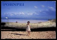 Lot 491 [2 of 2]:Micronesia: Dick Merritt Productions colour PPC of girl on beach with driftwood, franked with 10c Soldierfish block of 4 & 5c brown Men's House block of 4, cancelled with poor double-circle of OCT 18 1990, addressed to Australia.