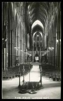 Lot 110:Great Britain: black & white real photo PPC of Westminster Abbey 'THE NAVE LOOKING EAST'.